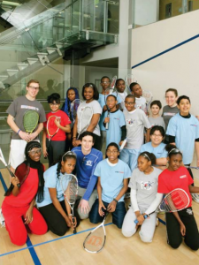 Christian Henze '10 (back row, left), Jessica Lovaas '06 (back row, right) and Tony Maruca '08 (front row, center) with StreetSquash students.