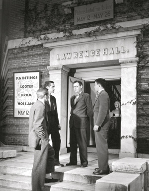 PAINTINGS LOOTED FROM HOLLAND: S. Lane Faison Jr. '29 (center) discusses an exhibition of Dutch masters' work that toured 13 U.S. cities, including a two-week run at the Lawrence Art Museum at Williams.