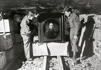 SAFEKEEPING: A self portrait by Rembrandt, inspected by Monuments Men Dale V. Ford (left) and Harry Ettinger, was one of thousands of paintings and other works of art stored in crates in the Hellbronn mine.