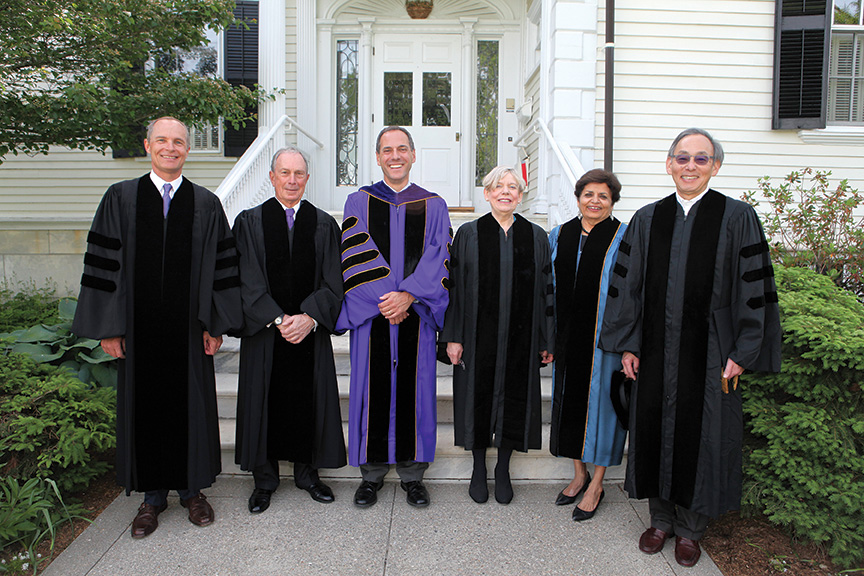 During the ceremony, President Adam Falk (in purple) bestowed honorary degrees on (from left) Gregory M. Avis '80, outgoing chairman of Williams' Board of Trustees and founding managing director of the venture capital and private equity firm Summit Partners: Michael R. Bloomberg, entrepreneur, philanthropist and three-term New York City Mayor; Karen Armstrong, award-winning religious scholar and author; Vishakha Desai, former president and CEO of the Asia Society; and Steven Chu, Stanford University physics professor and former U.S. Secretary of Energy.