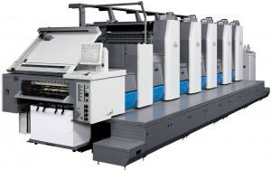 20th century Offset printing has become the most common commercial printing technology in use. An image is inked by a modern lithographic process and then transferred from a plate to the printing surface, usually paper, which is either fed into the machine in single sheets or from a large, continuous reel.
