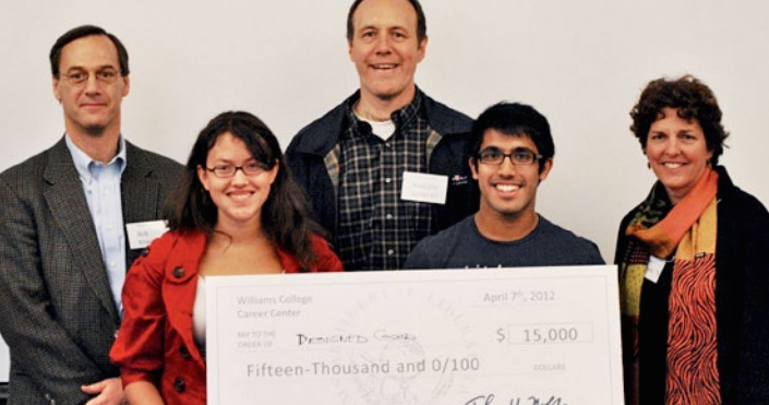 From left: (front row) Katy Gathright '12 and Imran Khoja '12 won a business plan competition judged by (back row) Bob Kraus '79, Malcolm Smith '87 and Laurie Thomsen '79