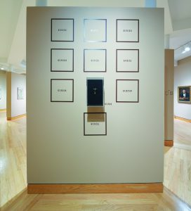 A photo of a display from WCMA that shows the accession numbers of artwork that the museum no longer has.