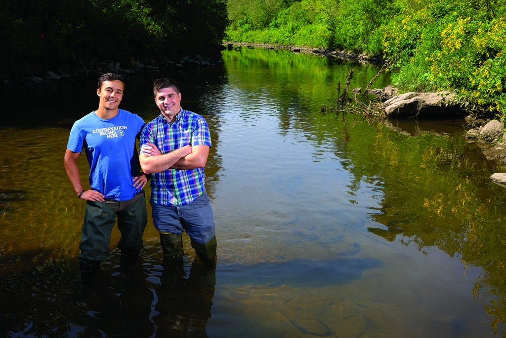 Picture of two men standing in the Housatonic river. Water up to their knees. Both wear waders.