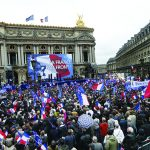 Members and supporters of France's far-right Front National (FN) party hold French flags as they attend a speech by FN president Marine Le Pen on the Place de Opera during the party's annual rally in honour of Jeanne d'Arc (Joan of Arc) on May 1, 2015 in Paris.