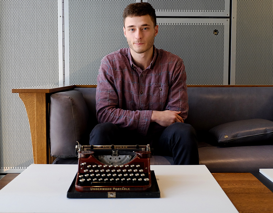 Portrait of a student with his typewriter.