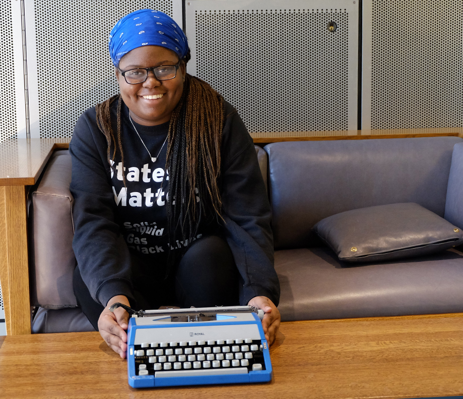 Portrait of a student with her typewriter.