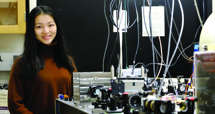 Bingyi Wang '18 in the laser lab, where she worked with physics professor Tiku Majumder.