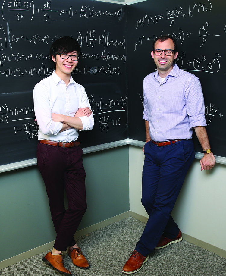 William Chen '19 (left) and economics professor Greg Phelan.