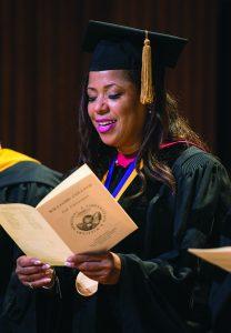 Photo of Bicentennial Medalist Cheryl C. (Robinson) Joyner, Class of 1985, reading convocation program.