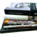 Photo of stack of recent books by faculty.