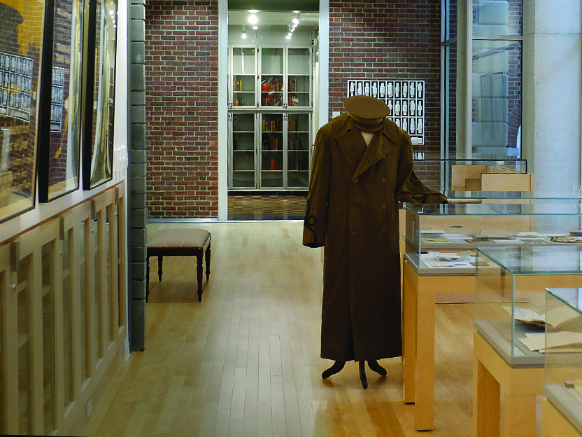 An Army great coat, both belonging to Charles Whittlesey, Class of 1905, on display in the library.
