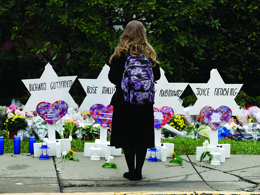 A photograph of a makeshift memorial commemorates those killed in a shooting at the Tree of Life Synagogue in Pittsburgh, Pa., in October 2018.