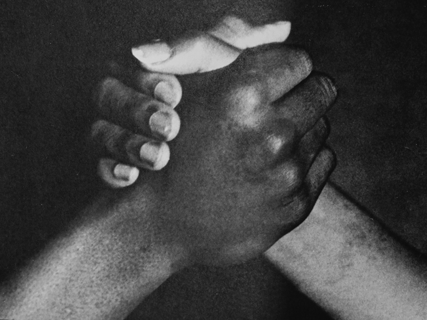 Black and white photo two hands clasping
