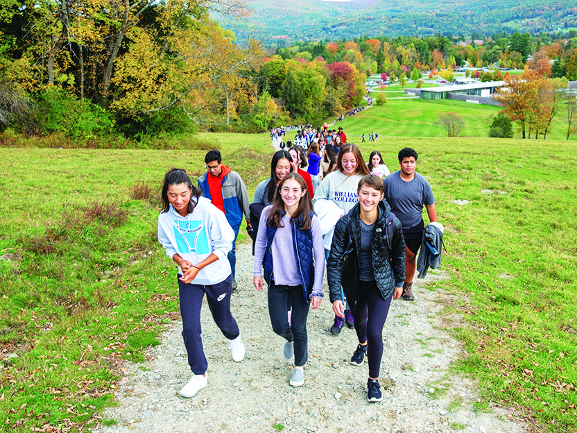 Photo of students walking up Stone Hill.