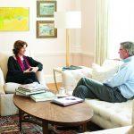 President Maud S. Mandel speaks with Tom Gardner '79, president of the Society of Alumni.