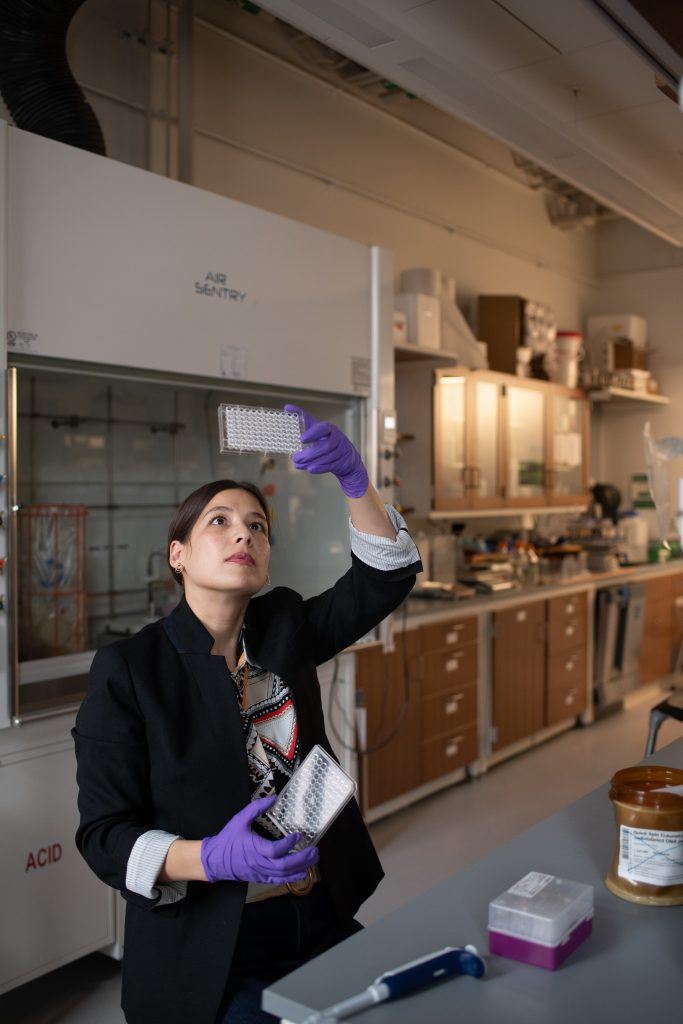 Photo of chemistry professor Katie Hart working in her lab
