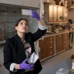 Photo of chemistry professor Katie Hart working in her lab