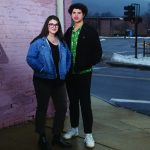 Portrait of Halle Schweizer and Michael Crisci standing outside.