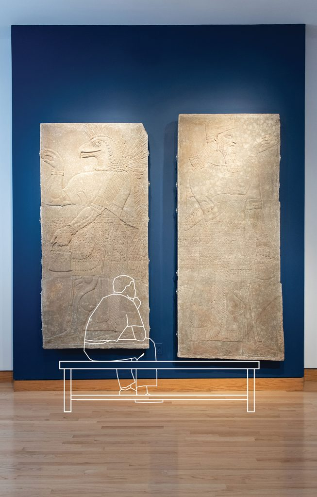 Photo of original relief panel with the outline of a person looking at it. An illustration.