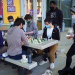 Photo showing students enjoying outdoor time while following pandemic restrictions