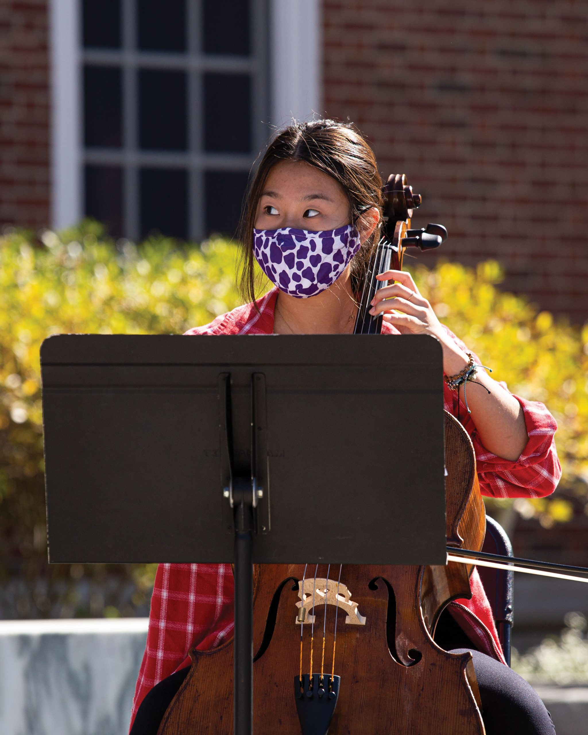 Grace Kim '23 of Cello Shots performs in front of the Paresky Center on Mountain Day in October.