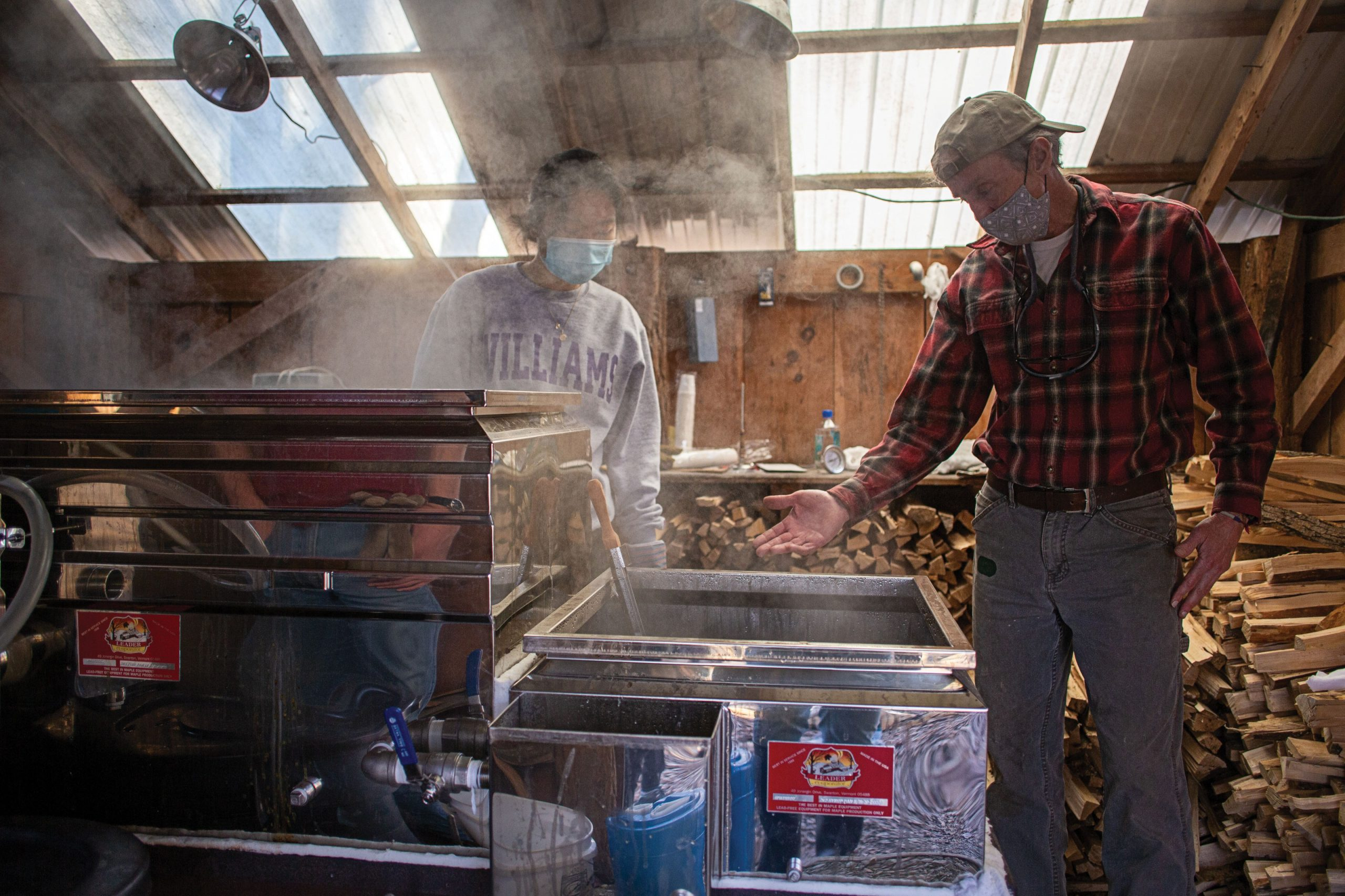 A student helps boil 135 gallons of sap from Hopkins Forest maple trees down to about four gallons of syrup in March.